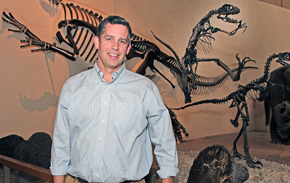 Peabody Director David Skelly in the Great Hall of Dinosaurs